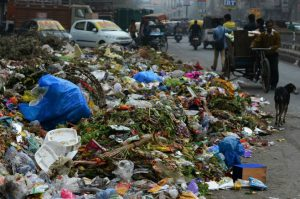 MCD workers on strike leave East Delhi reeling under garbage
